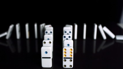 Domino falling on the ground in the slowmotion
