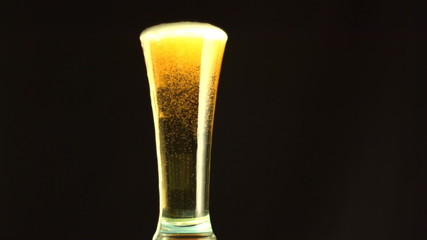 Beer overfilling a glass