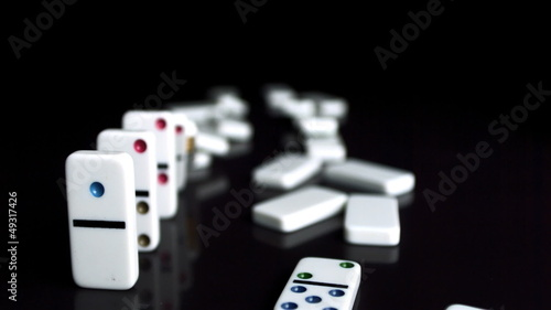 Line of dominoes falling down