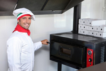 Pizzeria chef next to oven