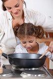 Mother cooking with daughter