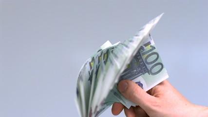 Hand waving hundred euro notes