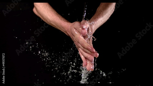 Man washing his hands under stream of water
