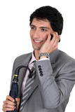 A polished businessman talking on his mobile phone