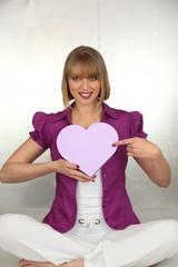 woman holding a hearth shaped box