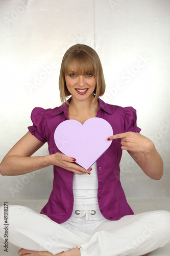 woman holding a hearth shaped box