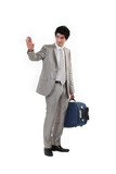 Man with suitcase waving goodbye
