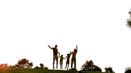 Family jumping in the air in park