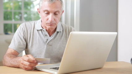 Man using his laptop and credit card