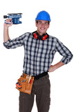 Young handyman holding electric sander poster