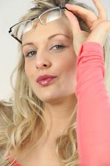 Blond seductively lifting glasses