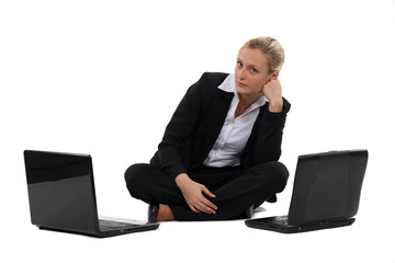 Woman sat with two laptops