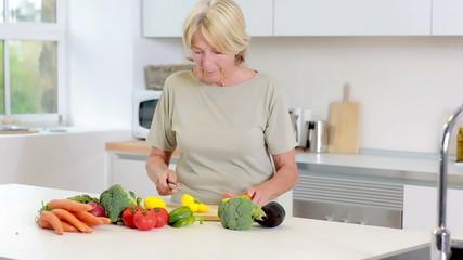 Old woman preparing vegetables