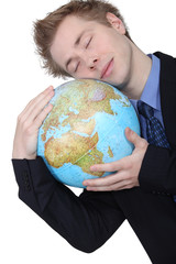 Relaxed man sleeping on a globe