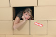 Woman surrounded by cardboard