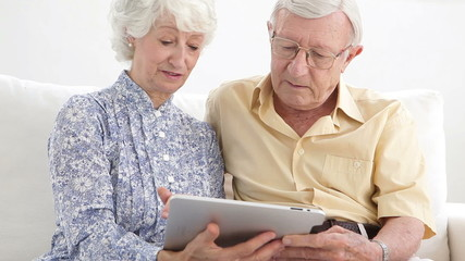 Old couple using a tablet