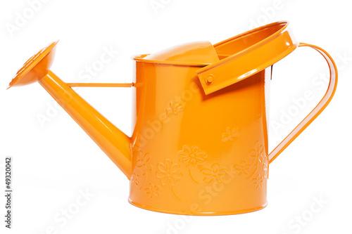 canvas print picture orangene giesskanne auf weissem hintergrund
