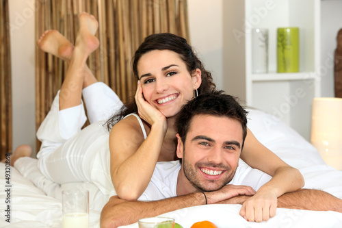 Couple laying in bed together