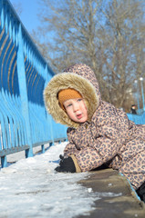 Baby girl in snowsuit on the snow