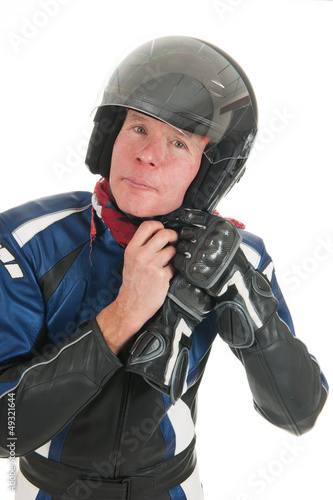 Portrait motor biker putting on his helmet
