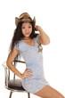 Asian woman blue dress sit smirk