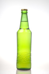 Beer in green bottle isolated on white