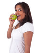 Young indian woman eating an apple