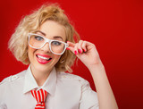Smile woman  wearing eyeglasses and looking you