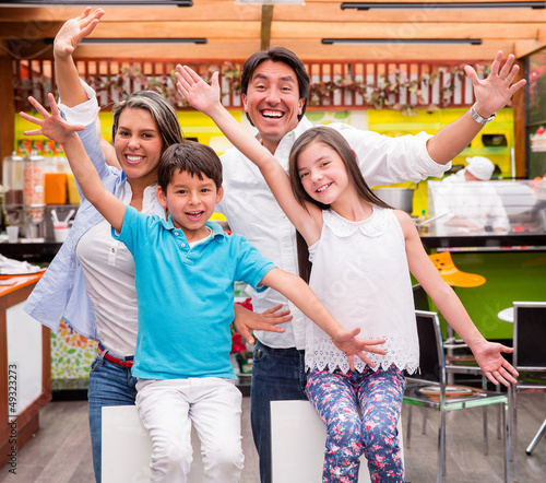 Excited family with arms up