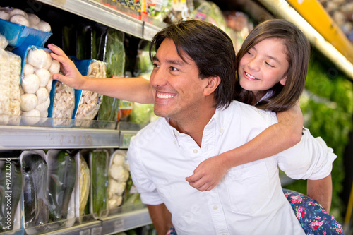 Father and daughter buying groceries