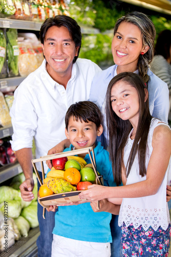 Healthy family at the local market