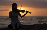 Silhouette of girl playing on violin classic music