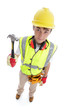 Builder standing with hammer