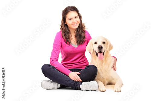 Young female posing with a retriever dog