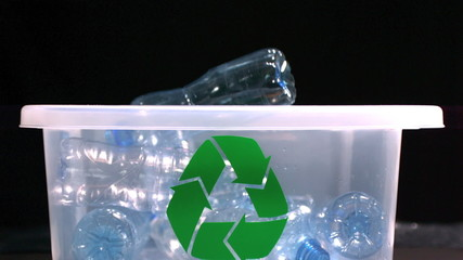 Bottle falling in recycle bin