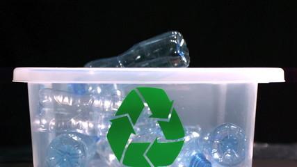 Bottle falling in recycle bin