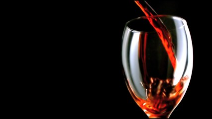Red wine flowing in super slow motion