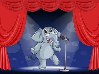 An elephant performing on the stage