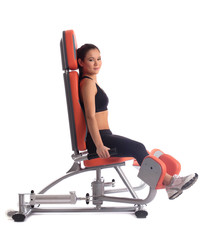 Young woman on hydraulic exerciser