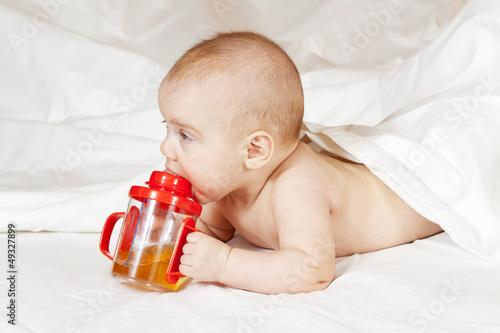 Little girl with baby bottle