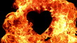 Flame of fire burning around a black heart in slow motion