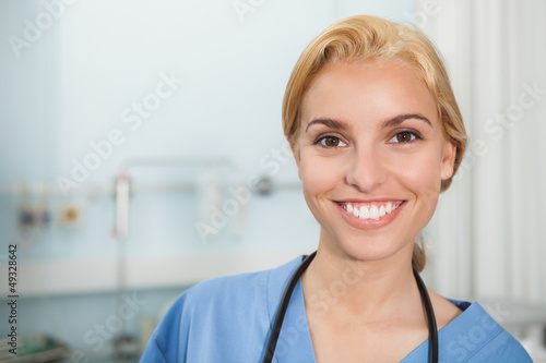 Front view of a nurse smiling while looking at camera