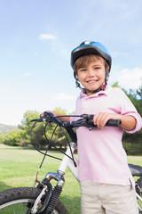 Happy boy with his bike