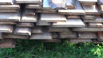 new fir planks on grass in farm