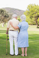 Elderly couple standing in a park
