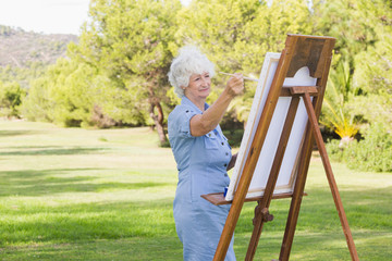 Woman painting in the park