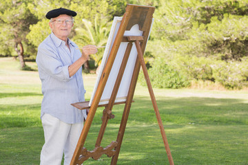 Portrait of man painting in the park