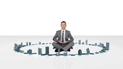 Businessman meditating with buildings rising around him