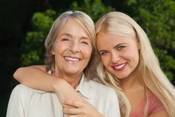 Mother and adult daughter hugging portrait