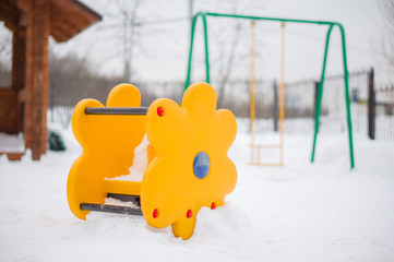 Swing construction and swing on back on winter playground